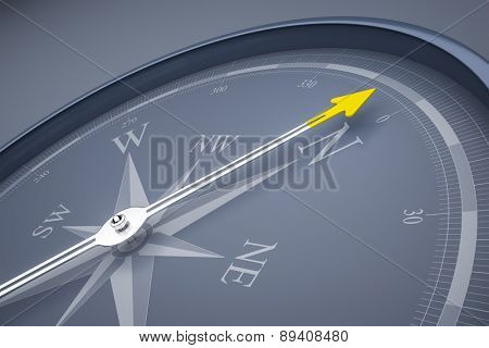 An image of a stylish compass with a yellow arrow