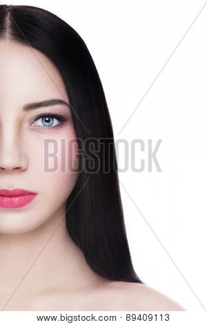 Portrait of young beautiful healthy blue-eyed brunette over white background, copy space