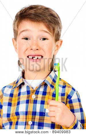 Little funny boy smiling at camera, with baby teeth dropped out. Healthcare. Isolated over white.