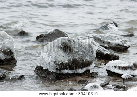Ice-covered Stones In Water