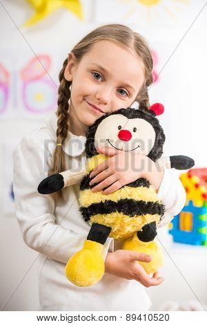 Little Girl With Toy Bee