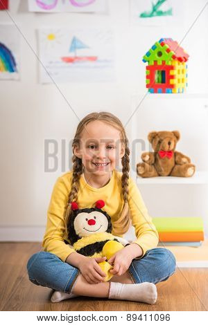 Girl With Toy Bee