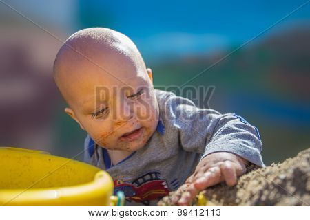 Baby playing in sandbox