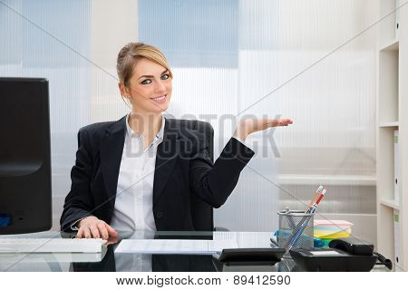 Businesswoman Displaying Invisible Product