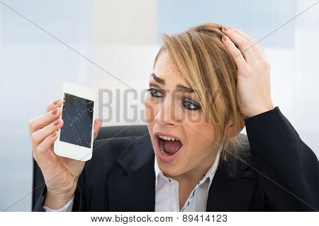 Businesswoman Holding Broken Smartphone