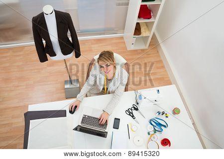 Fashion Designer Using Laptop