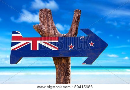 New Zealand Flag wooden sign with beach background