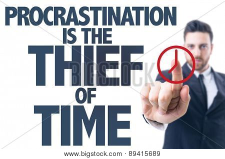 Business man pointing the text: Procrastination Is The Thief of Time