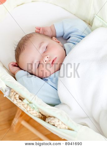 Adorable Baby Sleeping In His Bed