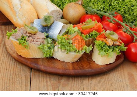 Baguette Slices With Herring, Salmon, Pollock, And Tuna