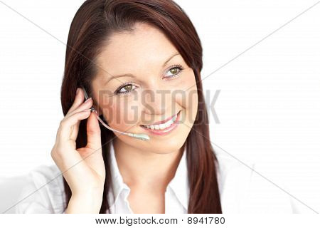 Pretty Young Businesswoman Wearing Headphones In A Customer Service