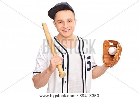 Young cheerful man in a white baseball shirt holding a baseball bat and a ball isolated on white background