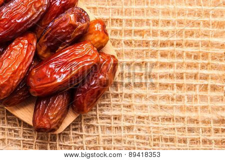 Dried Dates On Wooden Spoon Cloth Background