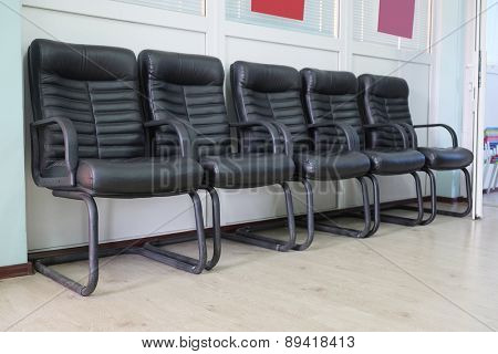Leather chairs in a row