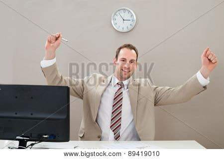 Happy Businessman At Desk