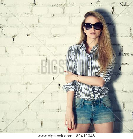 Fashion Photo of Hipster Woman at Brick Wall
