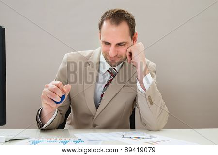 Businessman Squeezing Blue Stressball