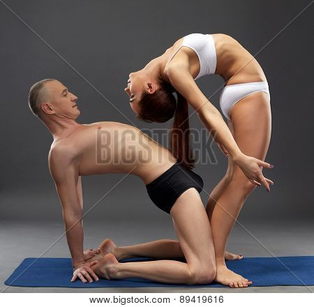 Image of flexible athletes. Yoga sessions in pair