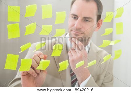 Businessman Making Notes On Adhesive Paper
