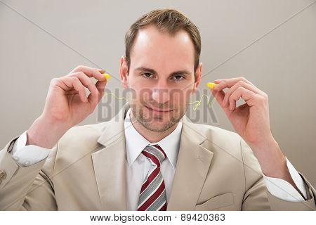 Businessman With Earplug
