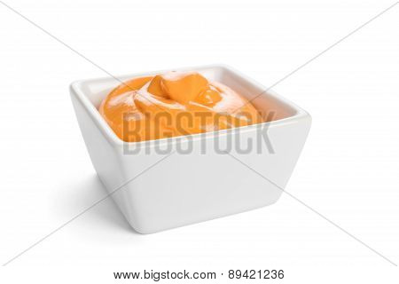 Chili sauce in a white dish isolated on a white background