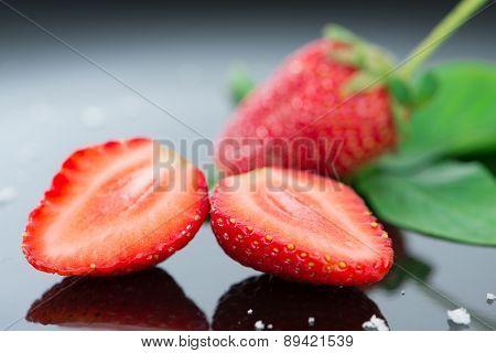 Fresh Strawberry On Black Background And Reflex