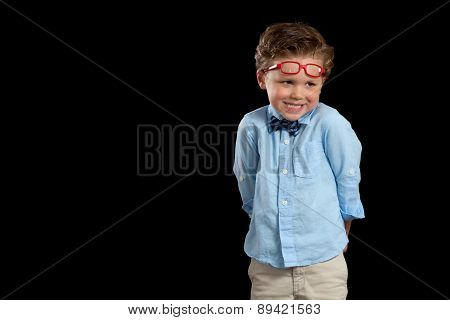 Boy Acting Silly With Red Glasses On Head