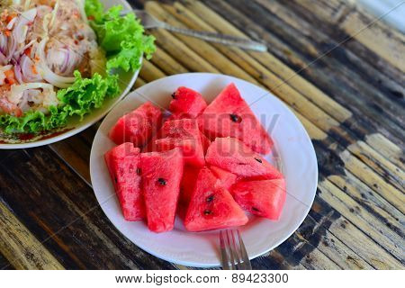 Closed Up Water Melon On Wood