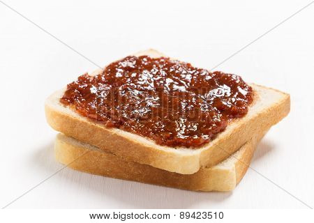 Two slices of bread with apricot jam