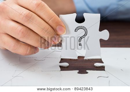 Person Hand Holding Puzzle With Question Mark
