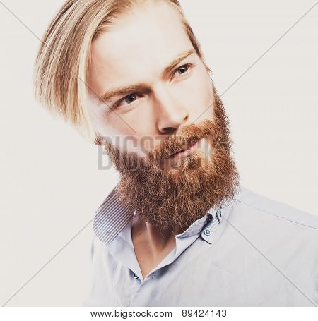 life style and people concept: young bearded man, casual style, close up. Isolated on white background.