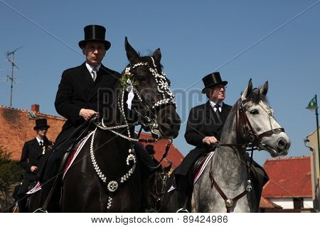 CROSTWITZ, GERMANY - APRIL 24, 2011: Easter Riders attend the Easter ceremonial equestrian procession in the Lusatian village of Crostwitz near Bautzen, Upper Lusatia, Saxony, Germany.