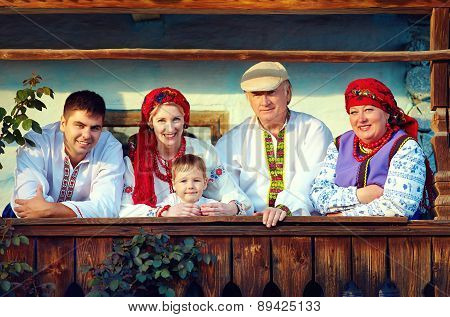 Happy Ukrainian Family On The Wooden Porch