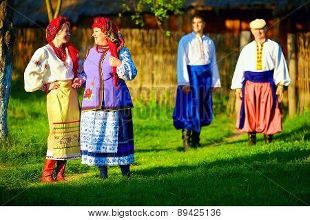 Group Of Ukrainian People Walking The Village After Folk Festivities