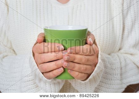 Person With Mug Of Hot Drink