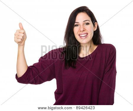 Brunette woman with thumb up
