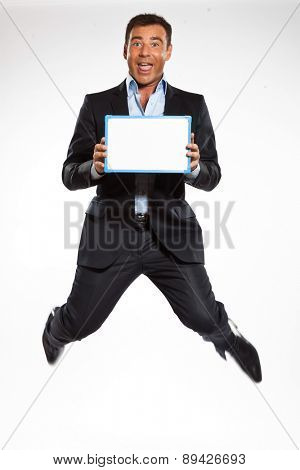 one  business man jumping holding showing whiteboard in studio isolated on white background