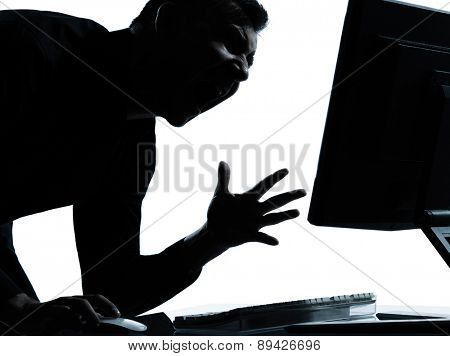 one  business man computing computer angry displeased portrait silhouette in studio isolated on white background