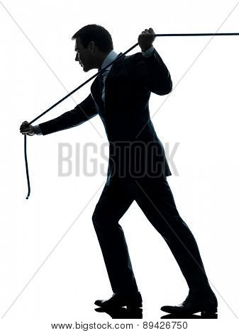 one  business man pulling a rope in silhouette studio isolated on white background