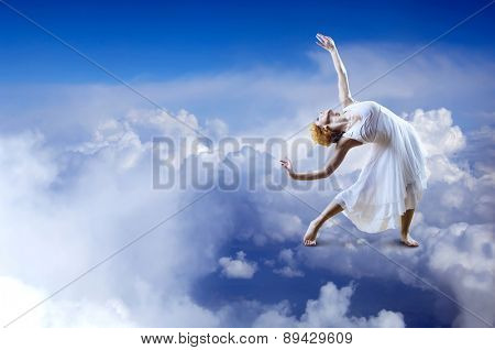 Ballerina stay on the sky clouds