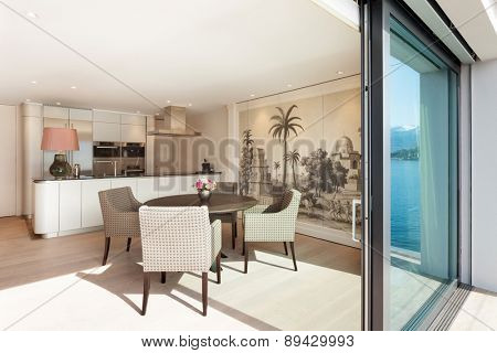 Interior beautiful apartment, elegant dining room view from veranda