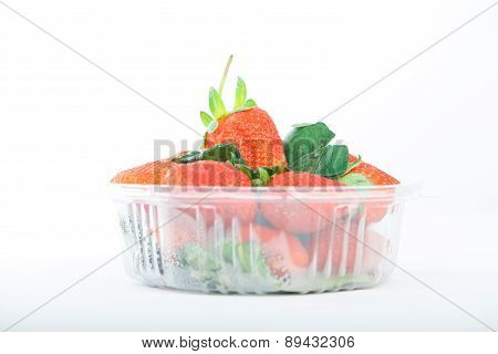 Strawberry In Plastic Box On White
