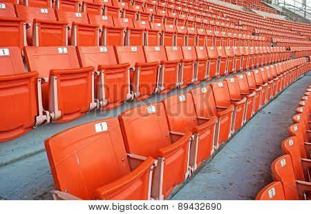 Bright red stadium seats  on the stadium sport