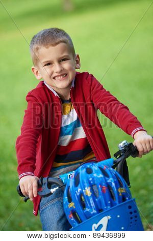 Young boy on the bicycle at Park