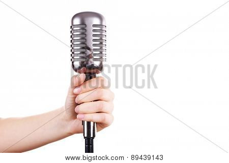 Retro microphone in female hand isolated on white