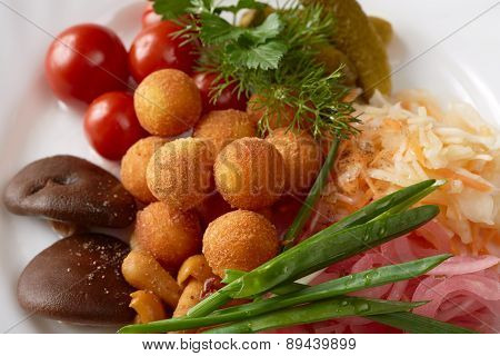 Close-up of cheese balls and pickled vegetables