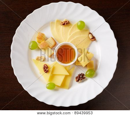 Dish with several kinds of cheese and sauce