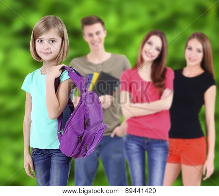 School students on nature background