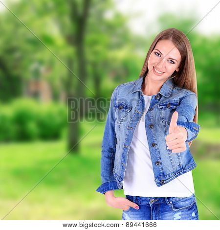 Beautiful young girl on nature background