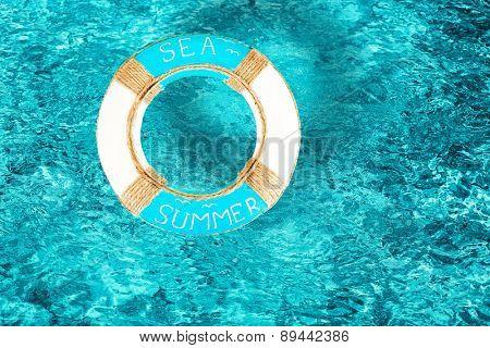Lifebuoy on water background